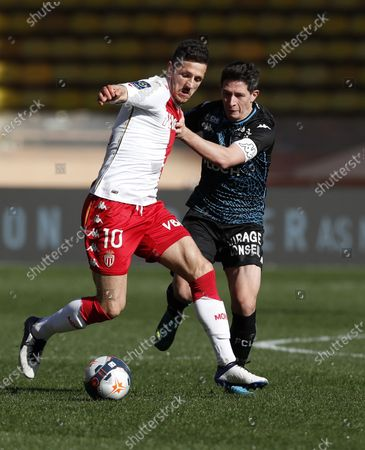 Stevan Jovetic (L) of AS Monaco and Laurent Abergel (R) of FC Lorient in action during the French Ligue 1 soccer match, AS Monaco vs FC Lorient, at Stade Louis II, in Monaco, 14 January 2021.