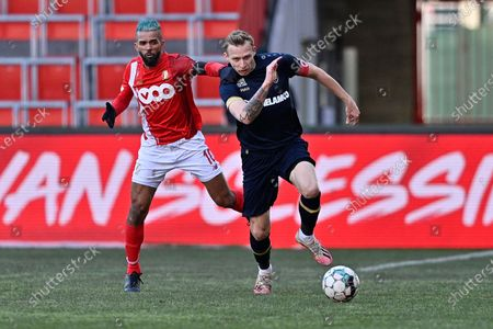 Standard's Mehdi Carcela and Antwerp's Ritchie De Laet fight for the ball during a soccer match between Standard Liege and Royal Antwerp FC, Sunday 14 February 2021 in Liege, on day 26 of the 'Jupiler Pro League' first division of the Belgian championship.