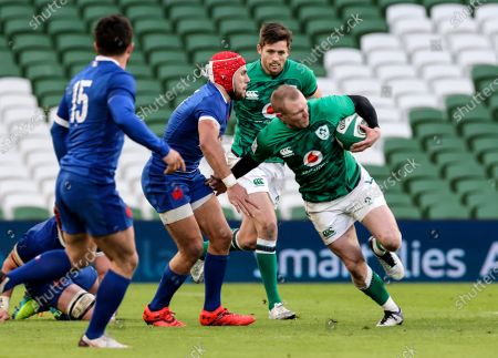 Ireland vs France. Ireland's Keith Earls comes up against Gabin Villiere of France