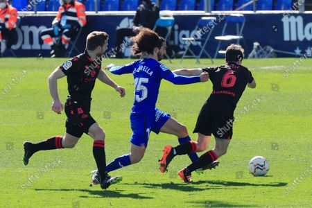 Stock Image of Getafe FC's defender Marc Cucurella (C) vies for the ball with Asier Illarramendi (L) and Aritz Elustondo (R), of Real Sociedad, during their LaLiga soccer match played at Coliseum Alfonso Perez in Getafe, Marid, Spain on 14 February 2021.