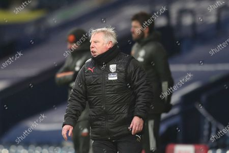 Stock Image of West Bromwich Albion's assistant coach Sammy Lee gives instructions from the side line during the English Premier League soccer match between West Bromwich Albion and Manchester United at the Hawthorns stadium in West Bromwich, England