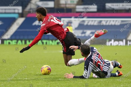 West Bromwich Albion's Robert Snodgrass, right, he tackles Manchester United's Marcus Rashford for which he was shown a yellow card by referee Craig Pawson during the English Premier League soccer match between West Bromwich Albion and Manchester United at the Hawthorns stadium in West Bromwich, England