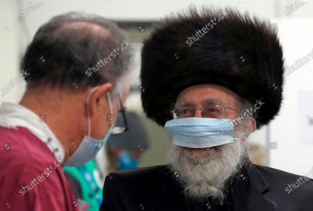 Member of the Haredi Orthodox Jewish community speaks to a doctor before his AstraZeneca vaccination at an event to encourage vaccine uptake in the ultra-Orthodox community at the John Scott Vaccination Centre in London, . In hopes of breaking down barriers that sometimes isolate the Orthodox from wider society, community leaders organized the pop-up vaccination event for Saturday night to coincide with the end of Shabbat, the Jewish day of rest