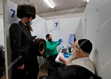 Nurse prepares a AstraZeneca vaccine at an event to encourage vaccine uptake in Britain's Haredi Orthodox Jewish community at the John Scott Vaccination Centre in London, . In hopes of breaking down barriers that sometimes isolate the Orthodox from wider society, community leaders organized the pop-up vaccination event for Saturday night to coincide with the end of Shabbat, the Jewish day of rest