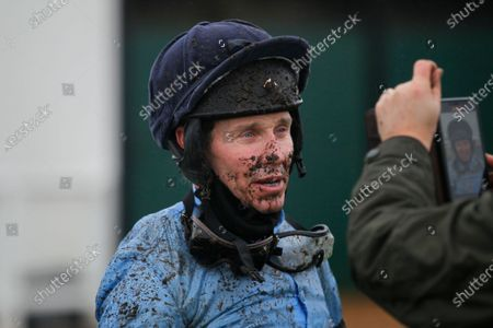 A very muddy Richard Johnson doing his video call at Exeter after his ride on Orby's Legend.