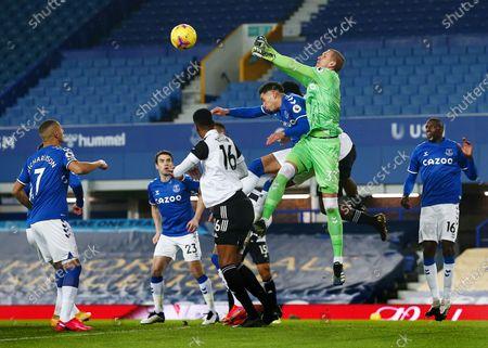 Everton goalkeeper Robin Olsen punches the ball clear