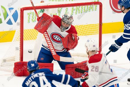 Stock Photo of Montreal Canadians goaltender Carey Price(31) makes a save on a shot from Toronto Maple Leafs center Auston Matthews(34) during an NHL hockey game, in Toronto, Canada