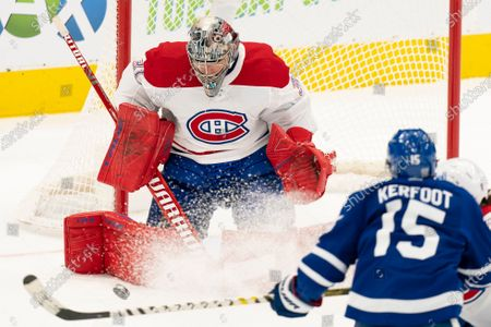 Montreal Canadians goaltender Carey Price(31) makes a save on a shot from Toronto Maple Leafs center Alexander Kerfoot(15) during an NHL hockey game, in Toronto, Canada