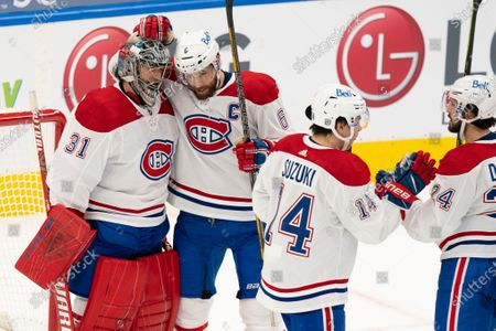 Montreal Canadians captain Shea Weber(6) celebrates with goaltender Carey Price(31) after their win over the Toronto Maple Leafs in an NHL hockey game, in Toronto, Canada