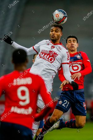 Brest's Christophe Herelle, left, and Lille's Benjamin Andre jump for the ball during the French League One soccer match between Lille and Brest at the Stade Pierre Mauroy stadium in Villeneuve d'Ascq, northern France