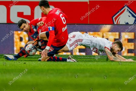 Lille's Benjamin Andre and teammate Jose Fonte tackle Brest's Paul Lasne, right, during the French League One soccer match between Lille and Brest at the Stade Pierre Mauroy stadium in Villeneuve d'Ascq, northern France