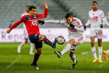 Lille's Benjamin Andre, left, duels for the ball with Brest's Romain Faivre during the French League One soccer match between Lille and Brest at the Stade Pierre Mauroy stadium in Villeneuve d'Ascq, northern France