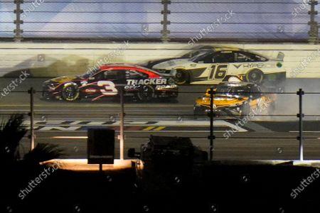 Austin Dillon, left, and Kaz Grala go by the Christopher Bell during the NASCAR Daytona 500 auto race at Daytona International Speedway, in Daytona Beach, Fla