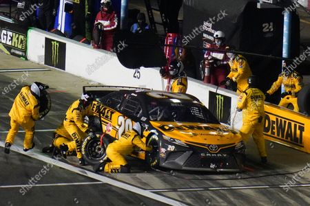 Christopher Bell makes a pit stop during the NASCAR Daytona 500 auto race at Daytona International Speedway, in Daytona Beach, Fla