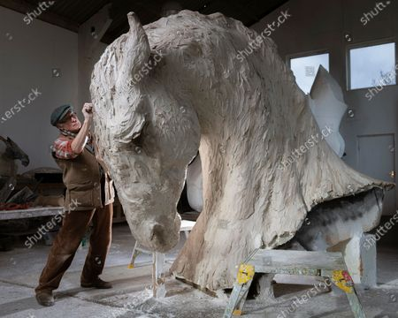 Leading British sculptor, Nic Fiddian-Green working on 'Mighty Horse, a 10 foot Clay which will be cast in Bronze next week.Nic has continued to work on his monumental sculptures throughout this challenging year of lockdowns.Nic says 'Nothing stops creativity.. it's what I do'. and I count myself very lucky to have my work. The piece will be included in his 'Monumental Sculpture Walk, in the landscape around his studio in the Surrey Hills that he hopes will open to the public this spring.'The walk will take about an hour passing 18 sculptures we have placed in this beautiful landscape where I have worked and been influenced by for 28 years, the landscape breaths into my work and the horse is ever understanding and speaks calmly into my soul