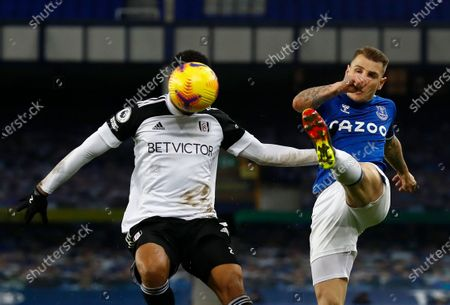 Fulham's Kenny Tete, left, duels for the ball with Everton's Lucas Digne during the English Premier League soccer match between Everton and Fulham at Goodison Park in Liverpool, England