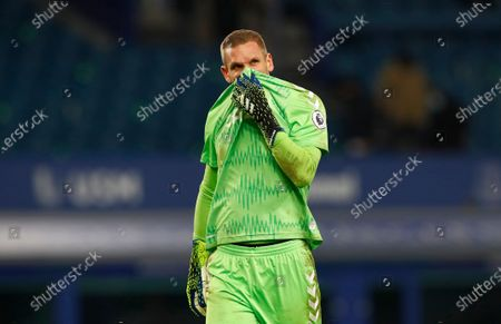 Everton's goalkeeper Robin Olsen wipes his face during the English Premier League soccer match between Everton and Fulham at Goodison Park in Liverpool, England