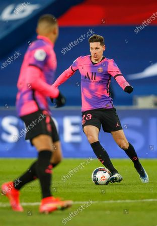 PSG's German midfielder Julian Draxler drives the ball in action with Kylian Mbappe (foreground)