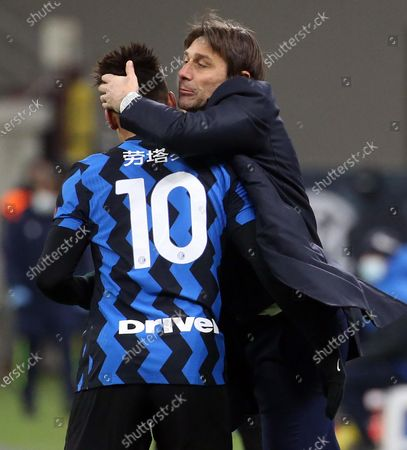 Inter Milan's Lautaro Martinez (L) celebrates with head coach Antonio Conte after scoring the 3-1 goal during the Italian Serie A soccer match between FC Inter and SS Lazio at Giuseppe Meazza stadium in Milan, Italy, 14 February 2021.