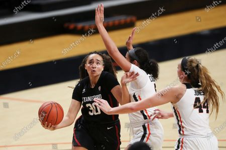 Stanford's Haley Jones (30) tries to get past Oregon State's Taya Corosdale, middle, and Taylor Jones (44) during the second half of an NCAA college basketball game in Corvallis, Ore