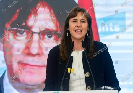 Catalan pro-independence party Junts per Catalunya (JxCat)'s presidential candidate Laura Borras (C) accompanied via videoconference by former Catalan President Carles Puigdemont (on screen) addresses a press conference after a meeting to analyze the first election results by the party at Hotel Barcelo Sants in Barcelona, Catalonia, north-eastern Spain, after the Catalonian regional elections, 14 February 2021.