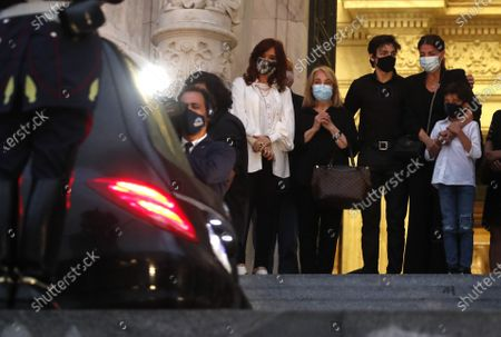 Senate President and Argentina's Vice President Cristina Fernandez, left, ex-wife of Carlos Menem Zulema Yoma, second left, and Zulema Menem, her daughter, right, watch the hearse with the remains of former Argentine as they arrive at Congress in Buenos Aires, Argentina. . Menem, who had been ailing in recent weeks has died Sunday