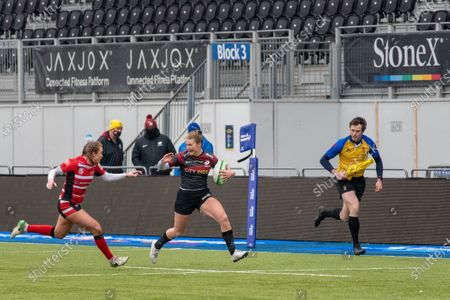 Kelly Smith (#14 Gloucester-Hartpury Women) chasing Sarah Mckenna (#15 Saracens Women)