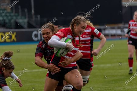 Kelly Smith (#14 Gloucester-Hartpury Women) gets tackled