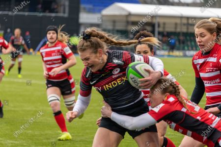 Lotte Clapp (#11 Saracens Women) being held by Kelly Smith (#14 Gloucester-Hartpury Women)