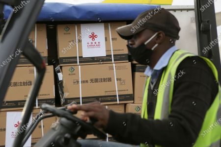Part of the Sinopharm COVID-19 vaccine from China is carried upon arrival at Robert Mugabe International airport in Harare, . Zimbabwe has received its first COVID-19 vaccines with the arrival early Monday of an Air Zimbabwe jet carrying 200,000 Sinopharm doses from China