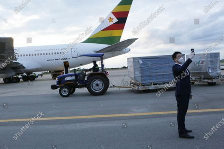 Part of the Sinopharm COVID-19 vaccine from China is transported upon arrival at Robert Mugabe International airport in Harare, . Zimbabwe has received its first COVID-19 vaccines with the arrival early Monday of an Air Zimbabwe jet carrying 200,000 Sinopharm doses from China