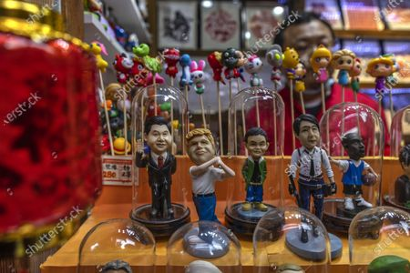 A man offers for sale figures representing celebrities such as (L-R) Chinese President Xi Jinping, Donald Trump, Jack Ma and others in his street shop for Spring Festival in Shanghai, China, 15 February 2021. Tourist attractions, sports venues, movies, and other attractions in Shanghai are flooded with people who could not go back home to celebrate the Spring Festival due to the new outbreak of COVID-19 in China, government regulations, and travel restrictions. Usually Spring Festival lasts 16 days, starting from Chinese New Yearâ€s eve to the Lantern Festival, and this year it is from 11. February to 26. February.