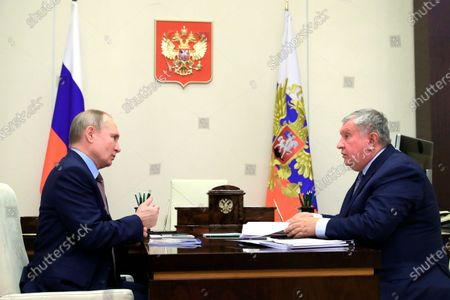 Stock Image of Russian President Vladimir Putin, left, and Russian CEO of Rosneft oil company Igor Sechin talk to each other during their meeting at the Novo-Ogaryovo residence outside Moscow, Russia
