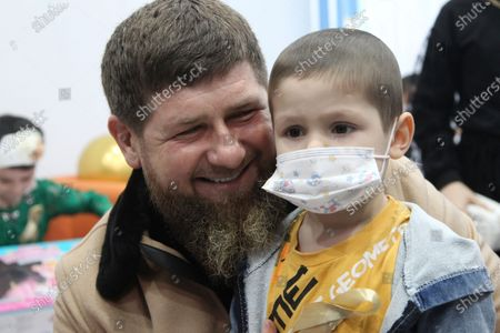 Chechnya's regional leader Ramzan Kadyrov speaks to a child as he visits a children's cancer center in Grozny, Russia