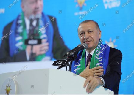 Turkish President Recep Tayyip Erdogan addresses his ruling party's supporters in the Black Sea city of Rize, Turkey, . Erdogan laid into the United States, accusing it of supporting Kurdish militants on Monday, days after Turkish troops found the bodies of 13 Turkish soldiers, police and civilians abducted by Kurdish insurgents in a cave complex in northern Iraq