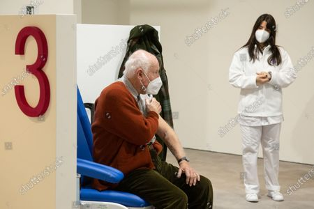 "A patient awaits vaccination in the new area dedicated to vaccinations in the ""Ennio Morricone"" Auditorium in Rome"