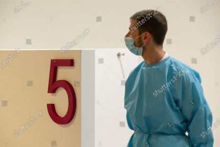 "Stock Image of A nurse in the new area dedicated to vaccinations in the ""Ennio Morricone"" Auditorium in Rome"