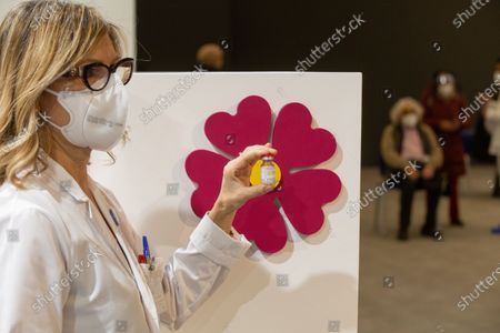 "A nurse shows the bottle of the Covid-19 vaccine in the new area dedicated to vaccinations in the ""Ennio Morricone"" Auditorium in Rome"