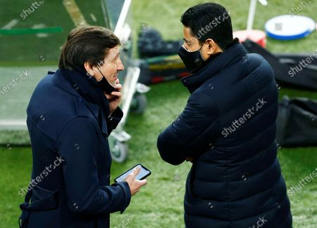 Paris Saint-Germain's president Nasser Al-Khelaifi (R) talks with Paris Saint-Germain's sports director Leonardo (L) during the team's training session at Camp Nou stadium in Barcelona, Catalonia, Spain, 15 February 2021, on the eve of the UEFA Champions League round of 16 first leg  soccer match against FC Barcelona.