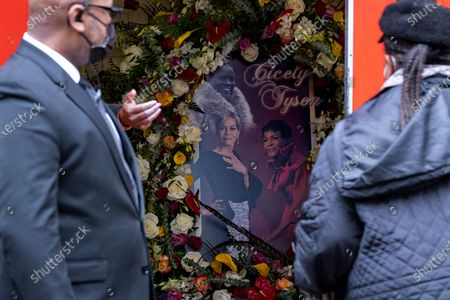 "Photo collage of Cicely Tyson greets people arriving just inside the Abyssinian Baptist Church in the Harlem neighborhood of New York where a public viewing was held, for Tyson, who died Jan. 28. Tyson, the pioneering Black actress who gained an Oscar nomination for her role as the sharecropper's wife in ""Sounder,"" a Tony Award in 2013 at age 88 and touched TV viewers' hearts in ""The Autobiography of Miss Jane Pittman,"" was 96"