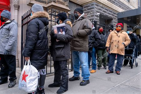 Stock Picture of People wait on line at the Abyssinian Baptist Church in the Harlem neighborhood of New York to attend a public viewing for Cicely Tyson, . Tyson, the pioneering Black actress died on Jan. 28