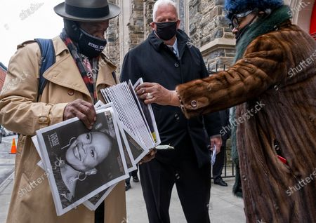 Stock Image of Vendor distributes a printed tribute to the late Cicely Tyson as people arrive for a public viewing at the Abyssinian Baptist Church in the Harlem neighborhood of New York . Tyson, the pioneering Black actress died on Jan. 28