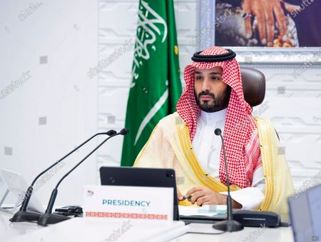Saudi Arabia's Crown Prince Mohammed bin Salman attends a virtual G-20 summit held over video conferencing, in Riyadh, Saudi Arabia. Saudi Arabia announced, that it plans to stop signing contracts with foreign companies that don't have their Mideast headquarters in the kingdom, state-run media reported, a bold move that could escalate business competition in the region