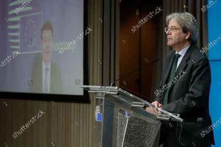 Eurogroup president Paschal Donohoe  (screen) and EU commissioner for Economy Paolo Gentiloni gives a press conference after a virtual Eurogroup meeting at the European Council in Brussels, Belgium, 15 February 2021.