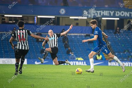 Chelsea defender Marcos Alonso (3) has a shot as Newcastle United midfielder Jonjo Shelvey (8) and Newcastle United midfielder Isaac Hayden (14) tries to block the shot during the Premier League match between Chelsea and Newcastle United at Stamford Bridge, London