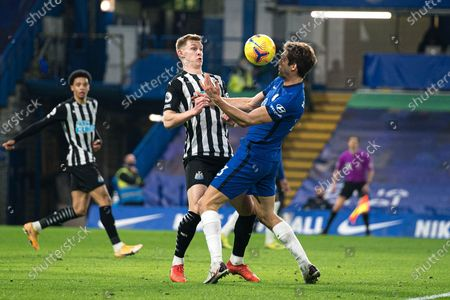 Chelsea defender Marcos Alonso (3) and Newcastle United defender Emil Krafth (17) battle for the ball during the Premier League match between Chelsea and Newcastle United at Stamford Bridge, London
