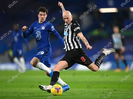 Newcastle's Jonjo Shelvey kicks the ball ahead of Chelsea's Mason Mount during the English Premier League soccer match between Chelsea and Newcastle United at Stamford Bridge Stadium in London, England