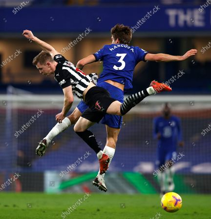Newcastle's Emil Krafth, left, and Chelsea's Marcos Alonso challenge for the ball during the English Premier League soccer match between Chelsea and Newcastle United at Stamford Bridge Stadium in London, England