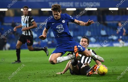 Chelsea's Marcos Alonso, left, and Newcastle's Andy Carroll challenge for the ball during the English Premier League soccer match between Chelsea and Newcastle United at Stamford Bridge Stadium in London, England