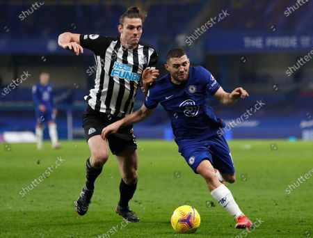 Chelsea's Mateo Kovacic (R) in action against Newcastle's Andy Carroll (L) during the English Premier League soccer match between Chelsea FC and Newcastle United in London, Britain, 15 February 2021.